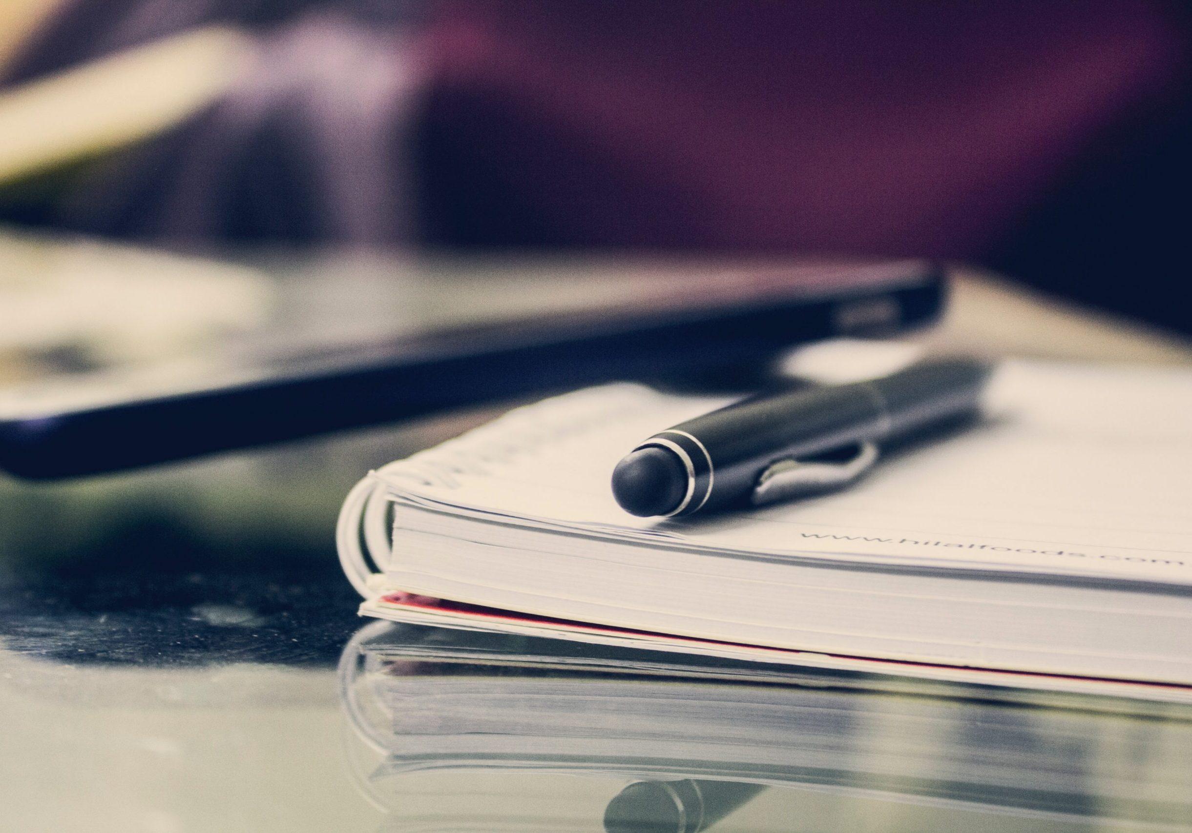 black-twist-pen-on-notebook-891059